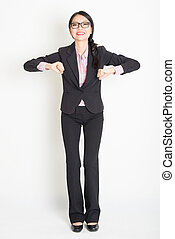 Asian businesswoman ready to jump - Full length front view...