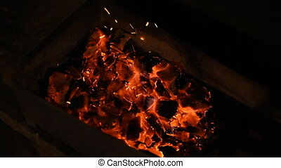 The coals in the grill.