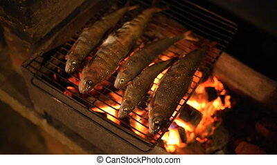 Fish baked on the grill. - Grayling fish is baked on the...