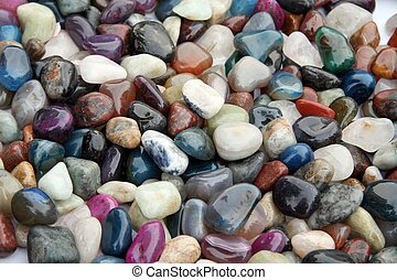 Multi-coloured ornamental stones - natural background -...