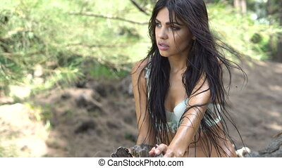 Beautiful brunette woman in the jungle - Sensual young...