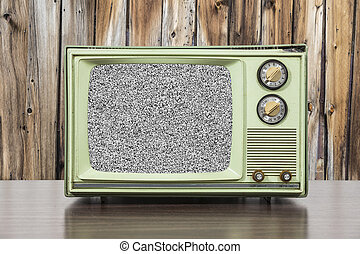 Grungy Green Vintage Television with Wood Wall and Static...