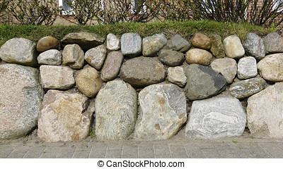 Frisian stone wall in front of a house