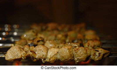 Roasting shish kebabs on the grill. We cook pork over hot...