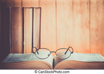 book and glasses - Book and Glasses with wood background