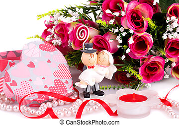 Wedding day - Red roses, bride and fiance, candle and gift...