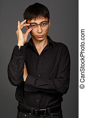 Young man in black shirt with glasses