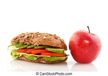 Brown wholemeal bread roll with red apple - Healthy lunch...