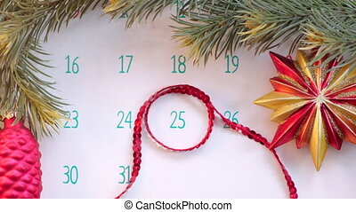 Christmas day on calendar page with holiday decoration