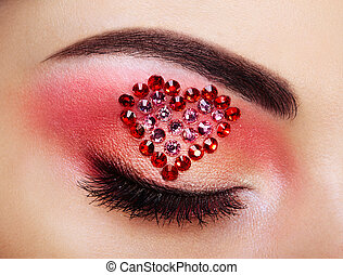 Eye make-up girl with a heart. Valentine's day makeup....