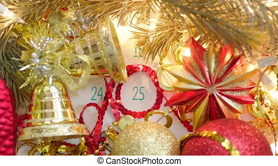 Christmas day on calendar page with holiday decoration -...