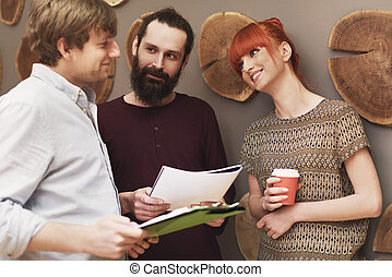 Group of people talking about business