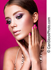 Beauty fashion model girl with bright makeup, long hair, manicured nails. Glamour woman isolated on pink studio background.