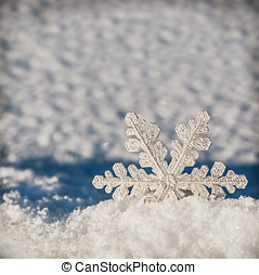 Christmas snowflakes on a snowy background
