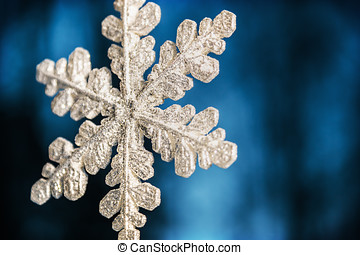 snowy snowflake on a blue background. Christmas decorations