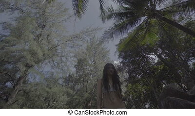 Beautiful brunette woman in the jungle - Down view of...