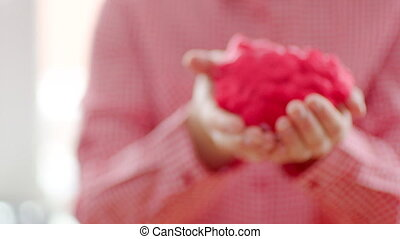 Woman keeping heart in her hands - Woman keeping red heart...