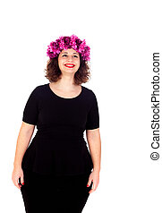 Happy girl with a branch and crown with pink flowers...