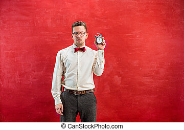 Young funny man with abstract clock - The young funny man...