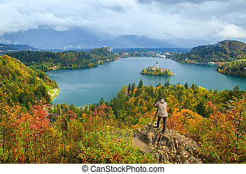 Photographer takes a picture near Bled lake.Slovenia