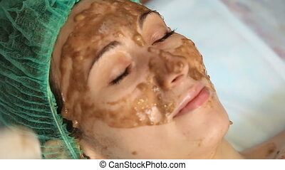 banana mask on a woman's face - banana mask on the woman's...