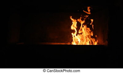 Fire is burning in the furnace. - Fire is burning in the...