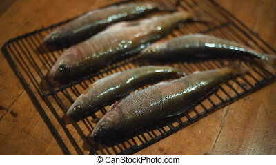 Fish on the grill on the table.