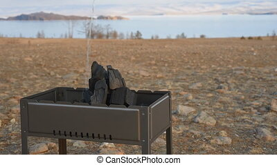 Barbecue stands on the shore of the lake. - Barbecue stands...