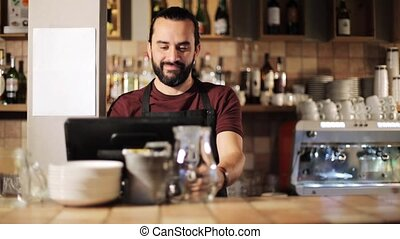 happy man or waiter at cashbox in coffee shop