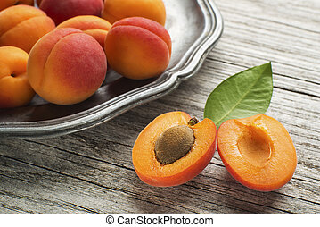 Apricots - Fresh Apricots on wooden table close up