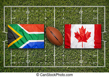 South Africa vs. Canada flags on rugby field
