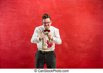 Young funny man with broken bouquet - The young funny man...