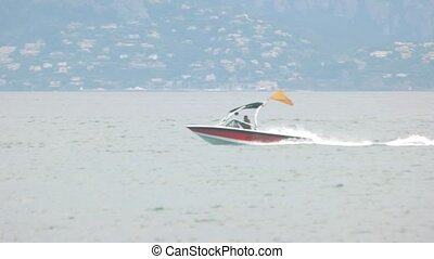 Boat and water skier. Fan of extreme sports.