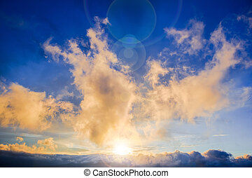 Beautiful scenic landscape with dramatic clouds and sunbeams of the setting sun.