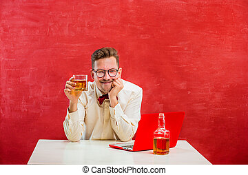 Young funny man with laptop at St. Valentine's Day - The...