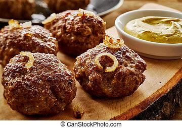 Tasty pan fried German meatballs with mustard - Tasty pan...