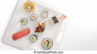 Picking and eating Japanese Sushi timelapse - Male hand...