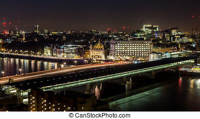 Blackfriars Bridge over the Thames at night - Panoramic view...