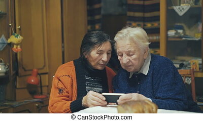 Two very old women speaking on the web chat 4K