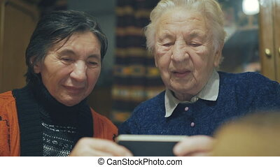 Two very old women speaking on the web chat