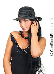 Beautiful woman in elegant black hat