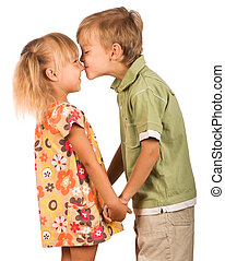 Friendly kiss - Little boy with girl isolated on white...