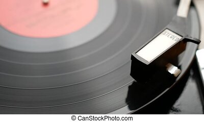 Record retro stereo player playing vinyl disk. Closeup scene