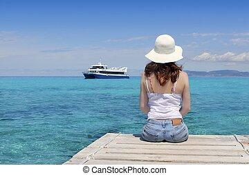 Tourist back woman looking Formentera turquoise sea Illetes...