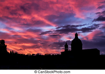 Silhouette of San Frediano - Sunset in Florence, Italy over...