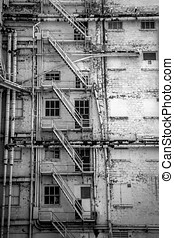 Stairs - A fire escape on an old building in downtown El...