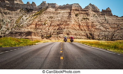 Side by Side - Two motorcyclists riding on a South Dakota...