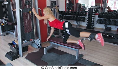 beautiful sporty woman doing workout in gym