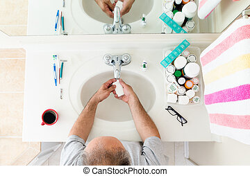 Overhead view of Man washing his hands at the sink