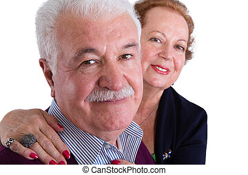 Happy Senior Business Couple Smiling at the Camera